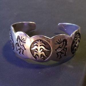Native sterling silver Kokopelli and corn cuff
